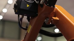 KIEV, UKRAINE - MART 11, 2016: The Robot Arm Performs Work at the Plant - stock footage