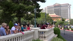 Tourists watch the show of Dancing fountains at the Bellagio. Las Vegas Stock Footage
