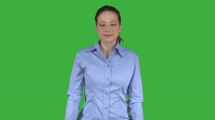 Professional woman takes a power pose (Green Key) Stock Footage