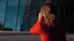 Businesswoman turn around answering call outdoor Stock Footage