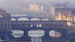 Florence italy ponte vecchio arno river zoom out Stock Footage