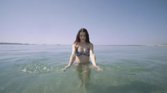Young adult swimming relaxing in sea - stock footage