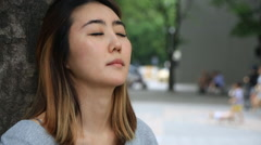 Young asian woman expressing her sad and depressing emotion Stock Footage