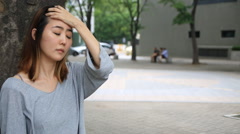 Young asian woman expressing her sad and depressing emotion with facial expressi - stock footage