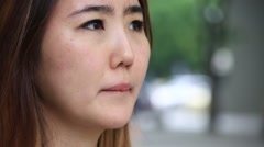 Close up shot of young asian woman expressing her sad and depressing emotion Stock Footage
