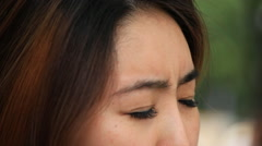 Close up shot of eyes of depressed asian woman - stock footage