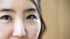 Close up shot of young attractive woman looking at camera and smiling - stock footage