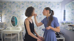 Master Colors eye shadows with color, image girl prepares for prom Stock Footage