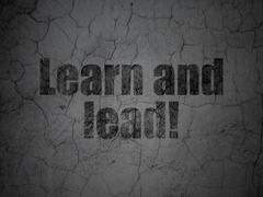 Studying concept: Learn and Lead! on grunge wall background Stock Illustration
