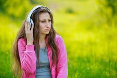 Girl with white headphones Stock Photos