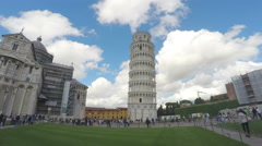Travelers visiting famous leaning Pisa tower in Italy. Summer clouds timelapse Stock Footage