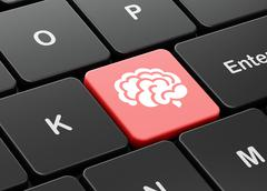Healthcare concept: Brain on computer keyboard background Stock Illustration