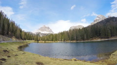 Lake Pragser Wildsee located in South Tyrol city in Italy, timelapse of clouds Stock Footage