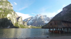Pragser Wildsee surrounded by mountains, timelapse of clouds above lake water Stock Footage