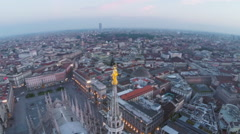 Duomo (Church) Milan, Aerial pan around spire (Madonna) Stock Footage