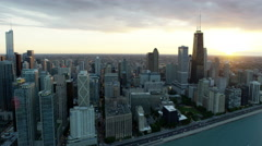 Aerial view of sun setting over Lake Michigan and Chicago city USA Stock Footage
