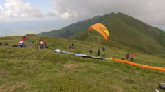 Para glider taking off the mountain - stock footage