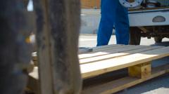 The Worker Loads the Flange on Pallets - stock footage