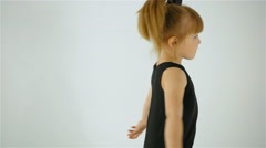 Cute Little Girl In Black Dress Dancing And Having Fun, Isolated On White Stock Footage