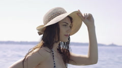 Young adult female wearing summer hat relaxing in sea - stock footage