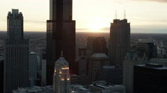 Aerial sunset silhouette of Willis Tower and Chicago city skyline USA Stock Footage