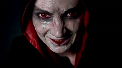 4k shoot of a horror Halloween model with evil bloody smile Stock Footage