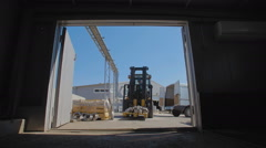 Forklift transports the flanges to the hangar - stock footage