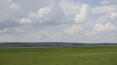 The beautiful landscape with river (lake) and green field. Real time capture Stock Footage