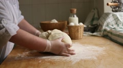 The dough is kneaded his hands Stock Footage