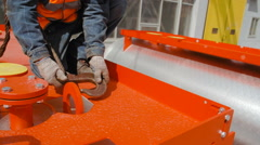 Worker Catches Crane Hook Stock Footage