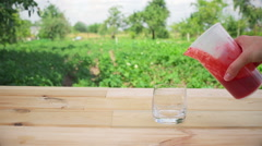 Transfusion strawberry smoothie from measuring cups into a glass Stock Footage
