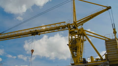 Yellow Hoisting Crane Lifting Cistern Stock Footage