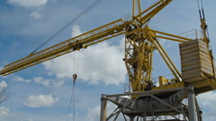 Yellow Hoisting Crane Moving with Cistern Stock Footage
