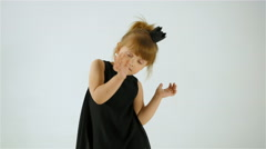 Cute Little Girl In Black Dress Dancing And Having Fun, Isolated On White - stock footage