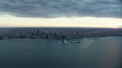 Aerial distant view at sunset of Chicago USA cityscape and Lake Michigan Stock Footage