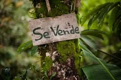 Wooden sign announcing real estate for sale in Costa Rica Stock Photos