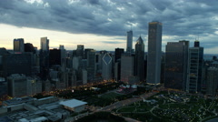 Aerial sunset view of Chicago skyscrapers and Millennium Park USA Stock Footage