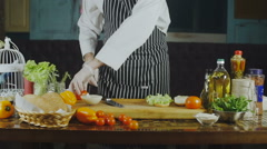 Chef Cuts the Tomatoes for a Sandwich Stock Footage