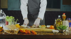 The Chef Cuts The Chicken For A Sandwich Stock Footage