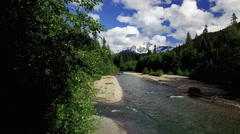 Mountain Trees Forest Aerial Above Flowing Sandy River Stream Stock Footage