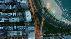 Aerial view at sunset of Chicago city buildings and waterfront Stock Footage