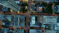 Aerial sunset view of illuminated Chicago city skyscraper buildings and freeways Stock Footage