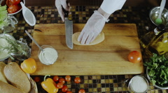 Chef Cuts Baguette by Knife Stock Footage