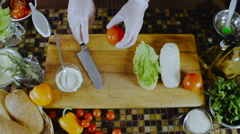 Chef Cuts and Puts Tomatoes On the Sandwich Stock Footage