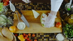 Chef Adds Cheese to the Sandwich - stock footage