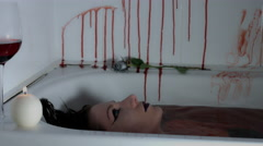 4k shoot of a horror Halloween model - Vampire diving in bloody water Stock Footage