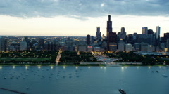 Aerial sunset view of downtown city skyscrapers and Lake Michigan Chicago USA Stock Footage
