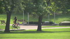 Girl ridding bike Stock Footage