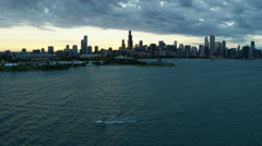Aerial sunset view of boats on Lake Michigan and city skyscrapers Chicago USA Stock Footage
