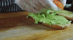 Chef Cuts Puts Tomatoes On the Sandwich Stock Footage